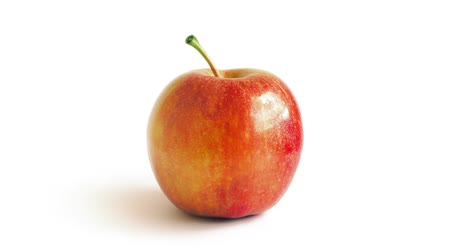 зеленый фон : Red Apple Rotating On White Background Стоковые видеозаписи