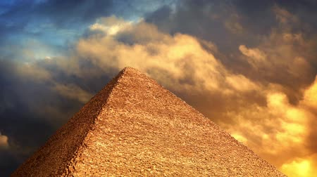 plagues : Pyramid With Golden Clouds Passing Above Stock Footage