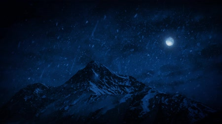 outside view : Snow Falling On Mountains At Night Stock Footage