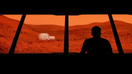 Марс : Astronaut Looks Out At Mars Base Стоковые видеозаписи