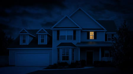 subúrbio : Person Turns On Light In House At Night Stock Footage