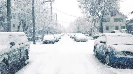 snows : Road In Suburbs In Snowstorm Stock Footage