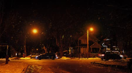 snows : Cars Passing Houses At Night In Snowfall