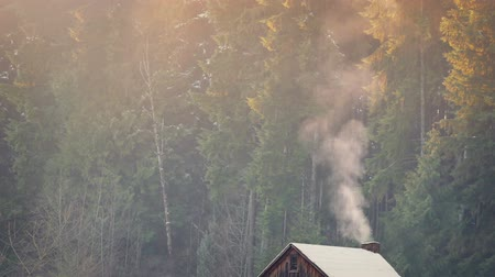 log cabin : Smoke Rises From Log Cabin In Winter
