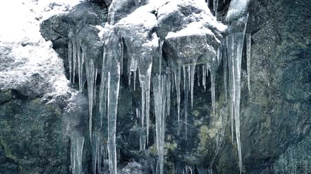 snows : Passing Icicles On Rock Face Stock Footage