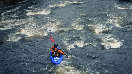 kayak : Kayak Passes On Big River Stock Footage