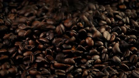 ristretto : Coffee Beans Pour Into Pile Closeup Stock Footage