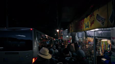 bogota : People Queueing For Coaches At Night In South America Town Stock Footage