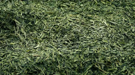сухой : Green Tea Leaves Rotating Slowly