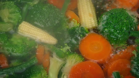 green peas : Mixed Vegetables Cooking In Boiling Water