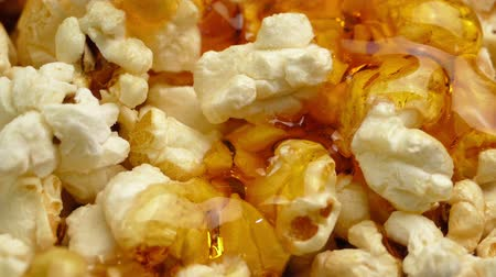 melts : Butter Sauce Pours On Popcorn Stock Footage