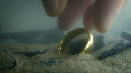 picked up : Someone Picks Up Gold Ring Underwater