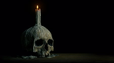 гот : Passing Old Skull With Candle Melted On It