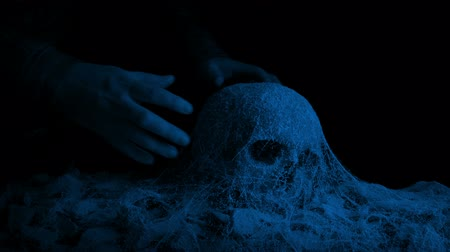 picked up : Man Picks Up Skull In Ancient Tomb At Night