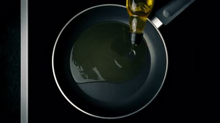 olive oil pour : Cooking Oil Poured In Pan Stock Footage