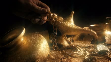 hoard : Magic Lamp Picked Up From Treasure Pile Stock Footage