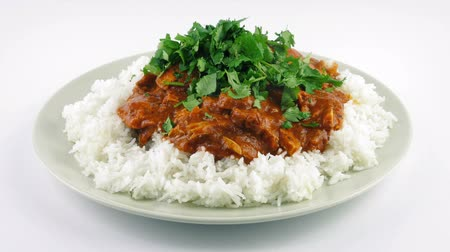 tikka : Curry And Rice Dish With Greens Added Stock Footage
