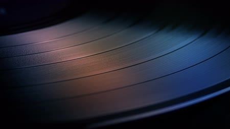 vinyl record : LP Turning In Disco Lights Stock Footage