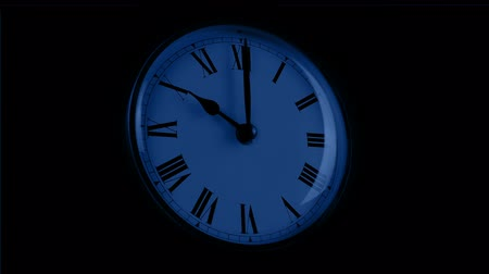 manor : Passing Clock Face In The Dark Stock Footage