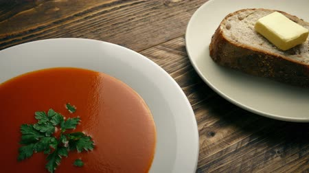 koriander : Tomato Soup And Bread On The Table