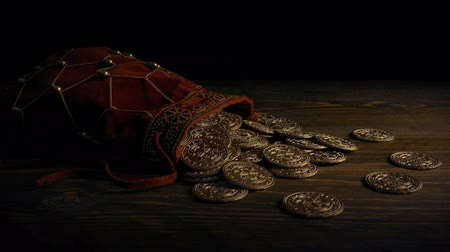 highwayman : Passing Bag Of Gold Coins On Table