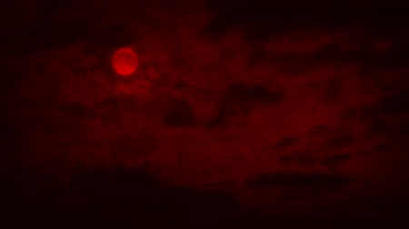 wicked : Red Moon With Clouds Passing Stock Footage
