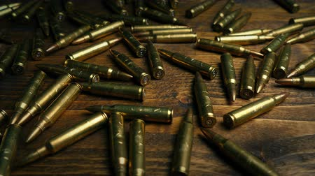 stash : Passing Bullets On Table Stock Footage