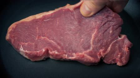 bloody hands : Beef Steak Placed In Frying Pan