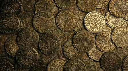 pile of money : Overhead Shot Of Antique Coins Rotating