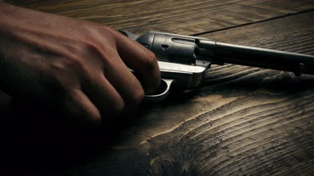 atirar : Gun Picked Up In Wild West Stock Footage