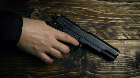 банда : Gun Picked Up By Hand And Gloved Hand