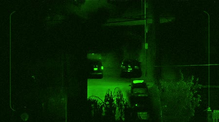 at the stake : Night Vision Tracking Car Driving Near Apartments