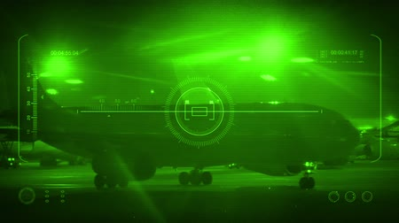 binocular : Plane Passes On HUD Night Vision Display Stock Footage