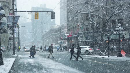 snows : People Cross City Road In Snowstorm