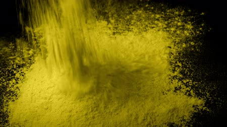 powdered : Yellow Powder Is Poured Into Pile