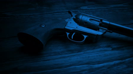 sheriff : Passing Cowboy Gun On Table At Night Stock Footage