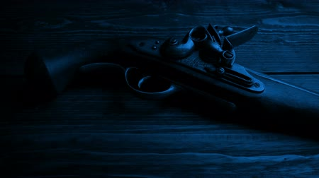 highwayman : Old Pistol Gun On Table In The Dark Stock Footage