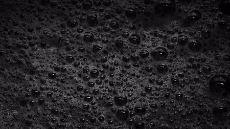 fizzing : Black Foam With Bubbles Popping