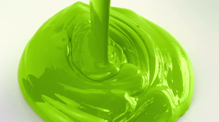 can : Green Paint Pouring Closeup Stock Footage