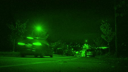 fbi : Cars Drive Down Hill In City Night Vision