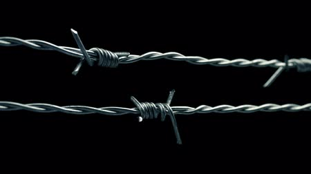 бункер : Passing Along Barbed Wire Closeup