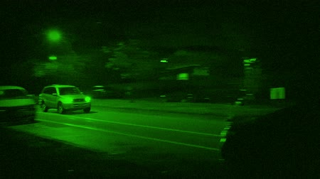 pelúcia : Cars Drive Past Houses In City Night Vision Stock Footage
