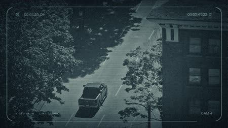 surveillance camera : CCTV Vehicles Passing Apartments In City Stock Footage