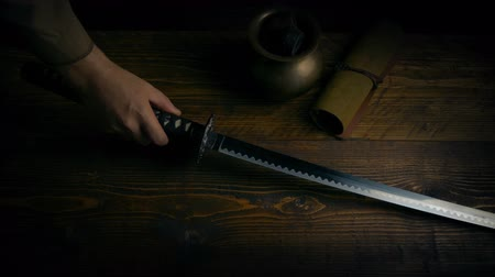 silahlar : Samurai Sword Picked Up And Put Down On Table Stok Video