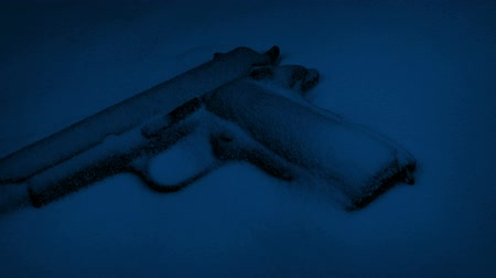 cold war : Hand Gun In The Snow At Night Stock Footage