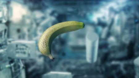 Марс : Banana Floating In Zero Gravity In Space Стоковые видеозаписи