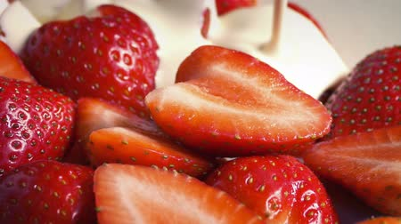 macro : Cream Pours On Strawberries