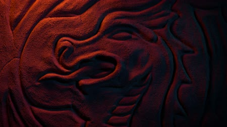 dino : Ancient Dragon Wall Carving In Fire Glow Stock Footage