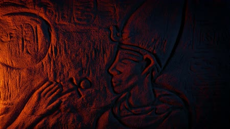 Ancient Egyptian Wall Carving In Fire Glow