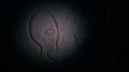 Torch Illuminates Alien In Egyptian Wall Art